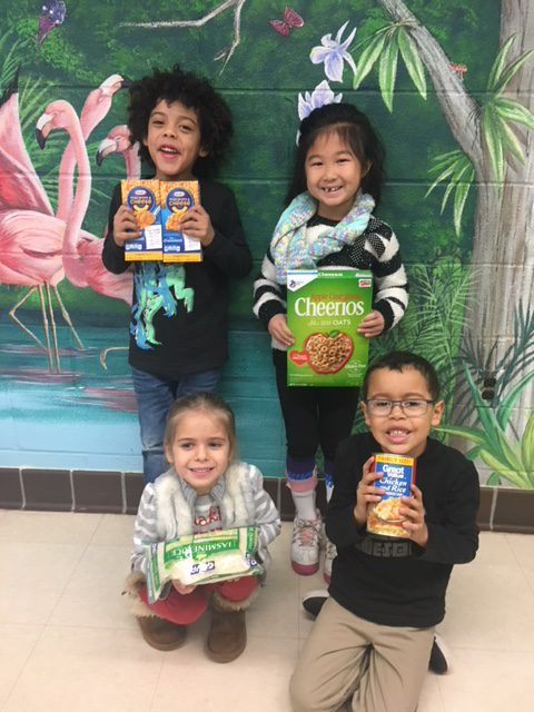 Students holding food donations